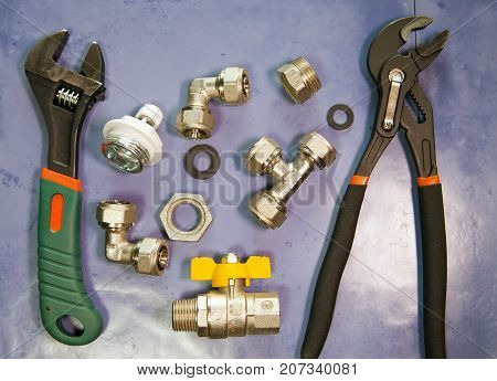 adjust wrench power grip groove joint pillers and elements of water and gas shutoff valves flat lay