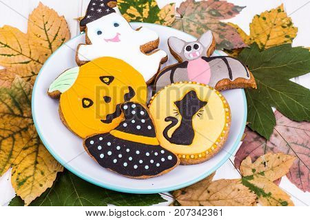 Funny delicious thematic homemade cookies with icing for Halloween on the wooden table. Studio Photo