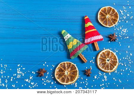 Christmas background with Christmas tree sachet filled with aromatic spices dried oranges and star anise. Space for text. Christmas gifts made by own hands. Original art project. DIY concept