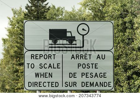 Sign for Trucking Weigh Station scale report weight on highway in Quebec Canada