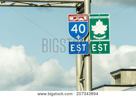 Signpost with green sign of the Trans Canada Highway east direction connecting the east- and west coast