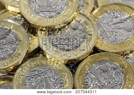 One pound coins in a pile - British Currency