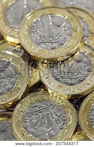 British one pound coins in a verteical format
