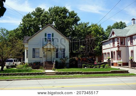 JOLIET, ILLINOIS / UNITED STATES - JULY 25, 2017: A small Cape Cod style home, on Broadway Street, in one of Joliet's less affluent neighborhoods.
