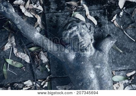 Partially destroyed ancient statue of the crucifixion of Jesus Christ (Faith religion suffering love God concept)