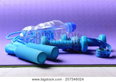 Dumbbells, Water Bottle And Jump Rope In Cyan Blue Color