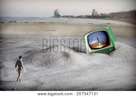 Dramatization of the end of the world, a man walks to an old television on the beach in Barcelona, North Korea has just launched a ballistic missile to Europe