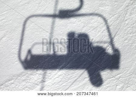 Shadows From Chair Lift With Snowboarder