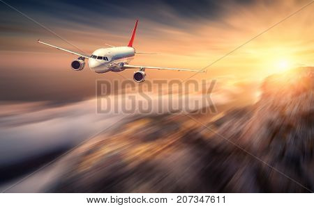 Modern Airplane Mith Motion Blur Effect Is Flying Over Low Clouds