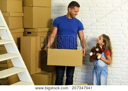 New Home And Family Concept. Daughter And Father Hold Box