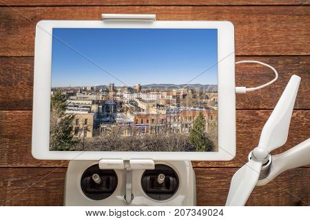Downtown of Fort Collins - reviewing aerial image on a digital tablet mounted on a drone radio controller
