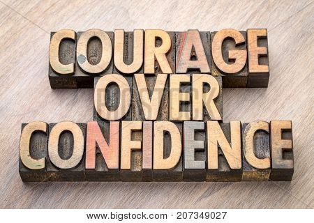 courage over confidence word abstract in vintage letterpress wood type