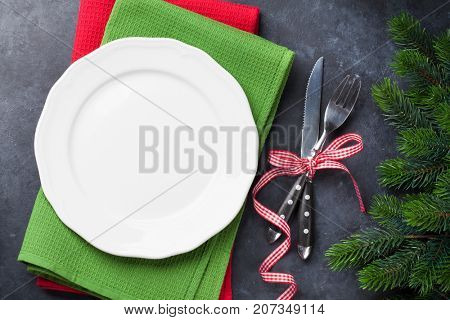 Christmas dinner plate, silverware, fir tree. Top view with copy space