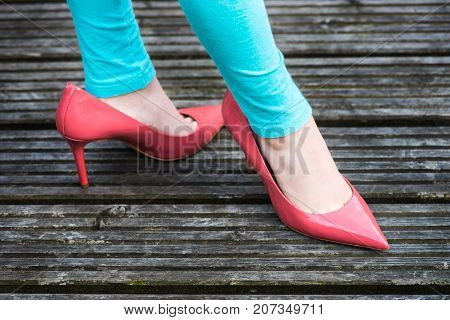 Little Girl Is Wearing Her Mothers Stiletto Shoes