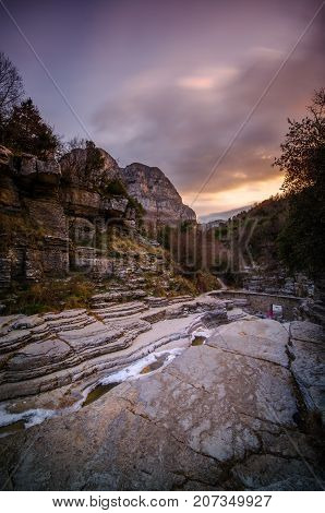 Kolymbithres of Ovires in winter with glacier. Natural small lakes in the rocks between two of the most beautiful villages in Zagori region, Megalo (Big) Papigo and Mikro (Small) Papigo, Greece.
