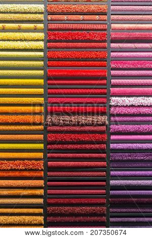 multicolored carpets samples on showcase