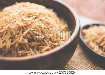 Stock photo of Brown basmati rice in raw form, selective focus
