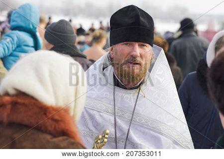 Ukraine Shostka - January 19 2017: Father on the Lake Galenkovka. Priest on Christian holiday Baptism in the Orthodox calendar.