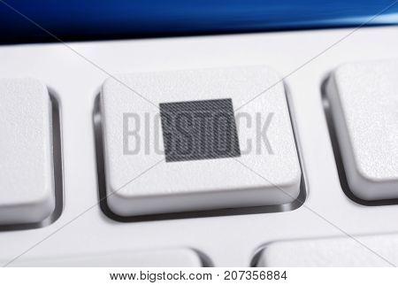 Macro Of A White Stop Button Of A White Remote Control For A Hifi Stereo Audio System