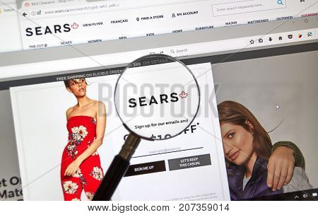 MONTREAL CANADA - OCTOBER 2 2017: Sears Canada web page under magnifying glass. Sears Canada is a Canadian retail chain headquartered in Toronto Ontario