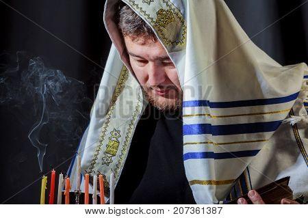 Man Lighting Candles In Menorah On Table Served Hanukkah