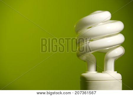 an energy efficient light bulb on a green background.