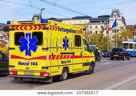 Zurich Switzerland - 29 September 2017: an emergency van of the Limmattal hospital on Quaibrucke bridge in the city of Zurich. In Switzerland the phone number for the emergency (German: Rettungsdienst) is 144 as painted on the van.