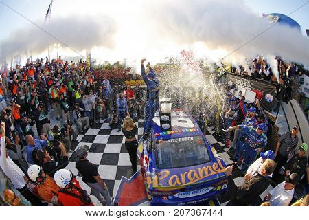 October 01, 2017 - Dover, Delaware, USA: Kyle Busch (18) takes the checkers flag and wins the Apache Warrior 400 at Dover International Speedway in Dover, Delaware.