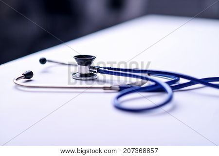 Stethoscope on a table in a doctor's office