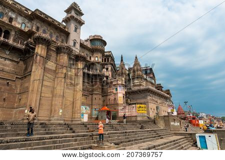 VARANASI INDIA - MARCH 14 2016: Horizontal picture of the nice architecture of Munshi Ghat in front of Ganges River in the city of Varanasi in India
