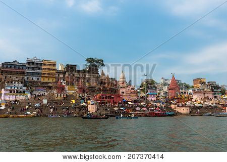 VARANASI INDIA - MARCH 14 2016: Wide angle picture Dashashwamedh Ghat in Ganges River during day time in Varanasi India.