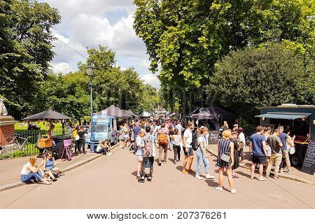 LONDON ENGLAND - AUGUST 6 2017; Crowd flocks to Victoria Park Saturday Market in lovely summer day to socialise and buy produce and food London England.