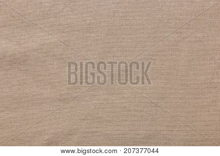 Burlap background and texture, The texture of the burlap, closeup with yellow tint