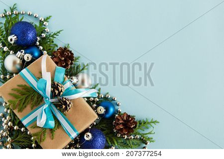 Christmas Flat Lay Composition Of Fir Branches With Gift Box And Decorations At The Left Bottom Corn