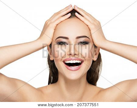 Portrait of cheerful young girl with a healthy face skin.  Frontal portrait of a happy woman with an open mouth. Pretty lady with fashion eye makeup.