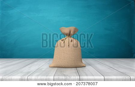 3d rendering of a blank tied up hessian bag full of money standing on a wooden surface on blue background. Lottery win. Jack pot money. Cash bag.