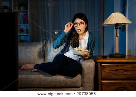 Lady Sitting On Sofa Couch Looking At Television