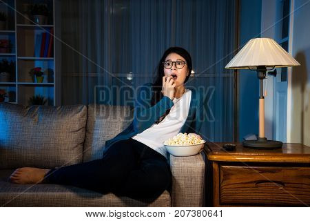 Beauty Elegant Girl Watching Horror Movie At Night