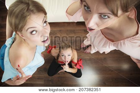 Woman being gossiped bullied by two female friends. Friendship difficulties rivaly and envy problems.