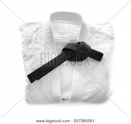 Karate uniform with black belt on white background