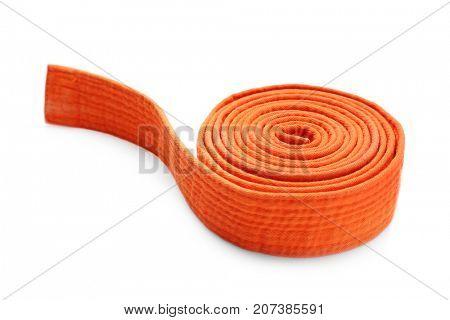 Orange karate belt on white background