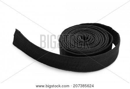 Black karate belt on white background
