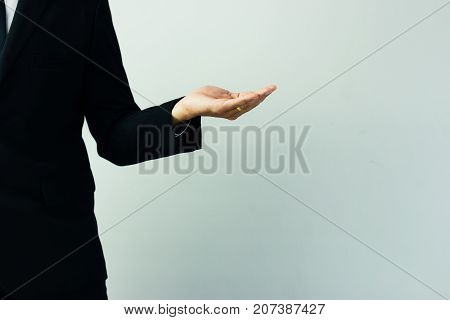 Business man with empty hand on white background.