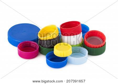 Few colored plastic bottle cap isolated on white background