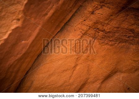 A beautiful closeup of a sandstone cliffs in Latvia. Close pattern of a sand formations. Sandstone caves at the seaside. Colorful photo of sandstone