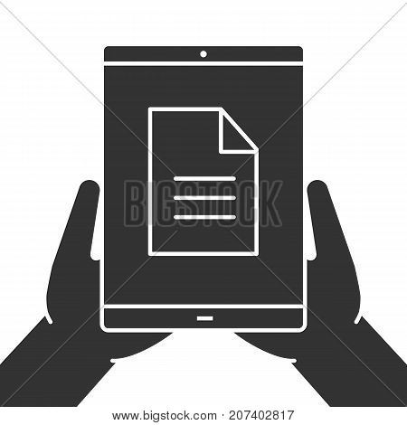 Hands holding tablet computer glyph icon. Silhouette symbol. Tablet computer with file. Negative space. Vector isolated illustration