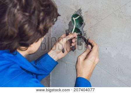 Electrician Installing Socket In New House