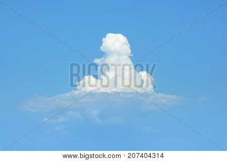 A cloud in the sunny sky. The white cloud like ice cream.