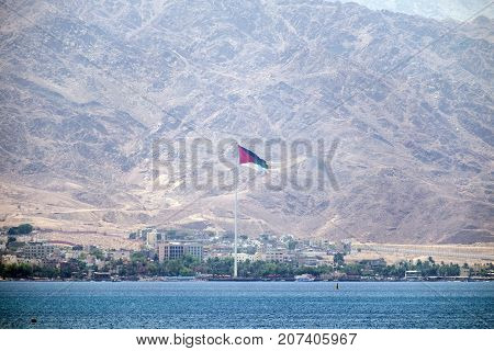 Red sea and coastline of Jordan against the backdrop of the towering mountains of Edom (Jordan, Aqaba)
