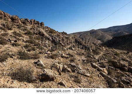 Rocky landscape of the Negev desert, near the city of Yeruham (Israel)